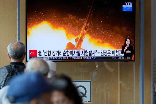 South Koreans watch coverage of missile launch (PA Images)