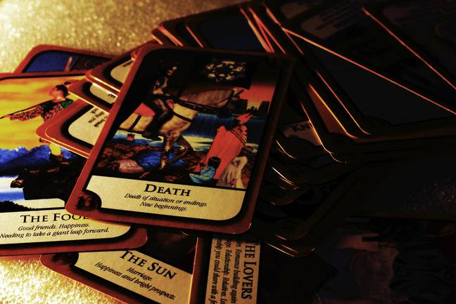 The psychic read the plaintiff's tarot cards in his session. (Alamy)