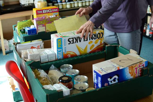Long-life items given away in boxes at a food bank (Alamy)