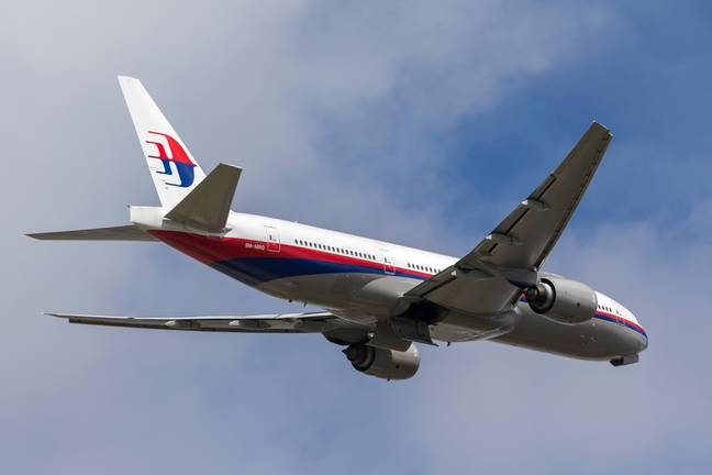 Malaysia Airlines Boeing 777 9M-MRG departing from Melbourne International Airport