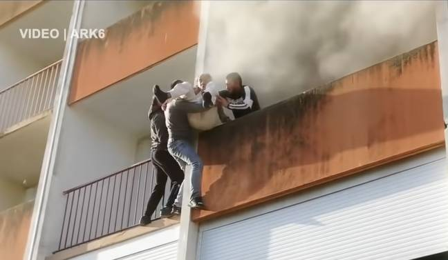 The elderly man was rescued by the three men. (RT)