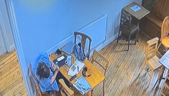 Hayley Budd checking under the table after the ghost moved the chair. (Kennedy News and Media)
