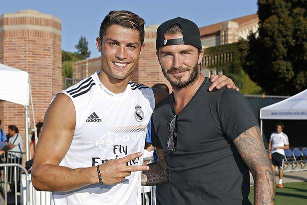 David Beckham To Make Cristiano Ronaldo First Miami Super Signing? Cristiano Ronaldo of Real Madrid and former player David Beckham pose after a training session at UCLA Campus 2103871