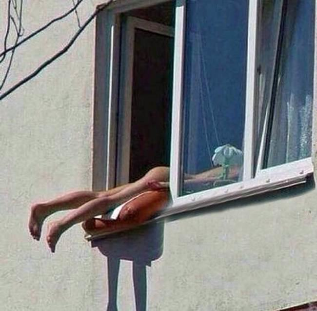 Woman Sunbathes Naked Out Of Window, Causes Car Crash ad 138036697 1