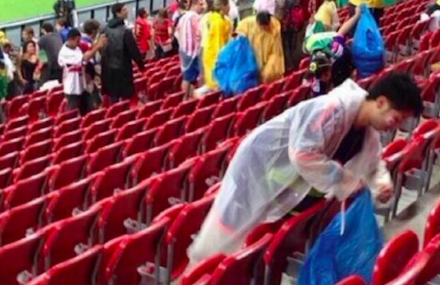 Japan Supporters Clean Up Their Mess After World Cup Defeat japan1