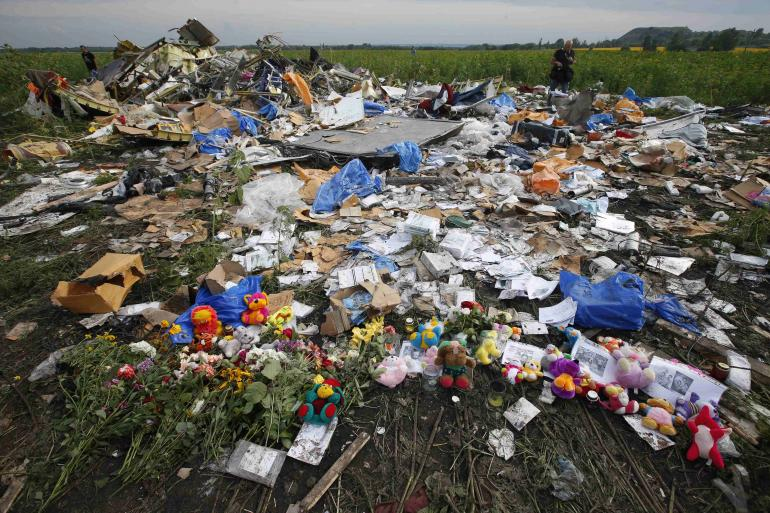 Ukrainian Woman Poses With Make Up Looted From MH17 Crash Site malaysia airlines flight mh17 crash site july 19 2014