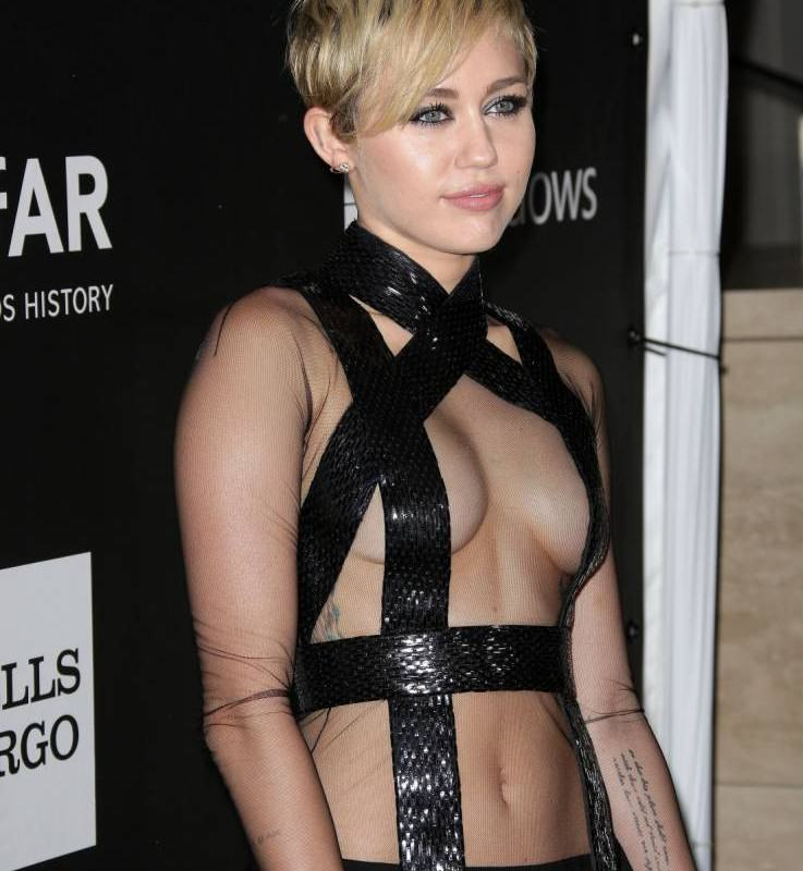 Miley Cyrus Leaves Absolutely Nothing To The Imagination, Again ad 150258418 e1414660179762 737x800