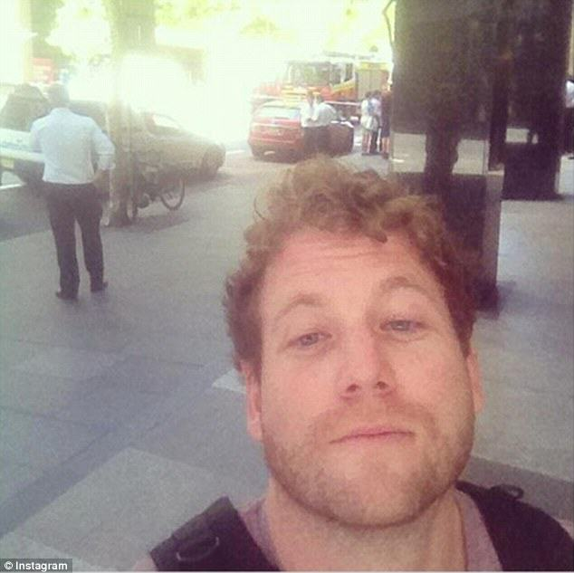 People Are Taking Selfies Outside The Terror Siege Thats Happening In Sydney 240F525800000578 2874191 These three men also looked pleased to be in Martin Place despit a 2 1418630836938