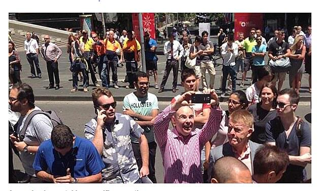 People Are Taking Selfies Outside The Terror Siege Thats Happening In Sydney 240F5A1600000578 2874191 This man couldn t contain his happiness at taking a selfie near  a 2 1418643053133