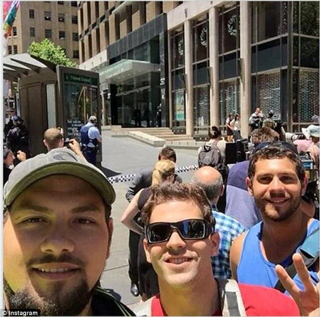 People Are Taking Selfies Outside The Terror Siege Thats Happening In Sydney hostage 1