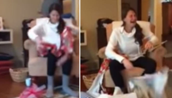 Girl Completely Loses It After Being Proposed To On Christmas Day present 2 web thumb
