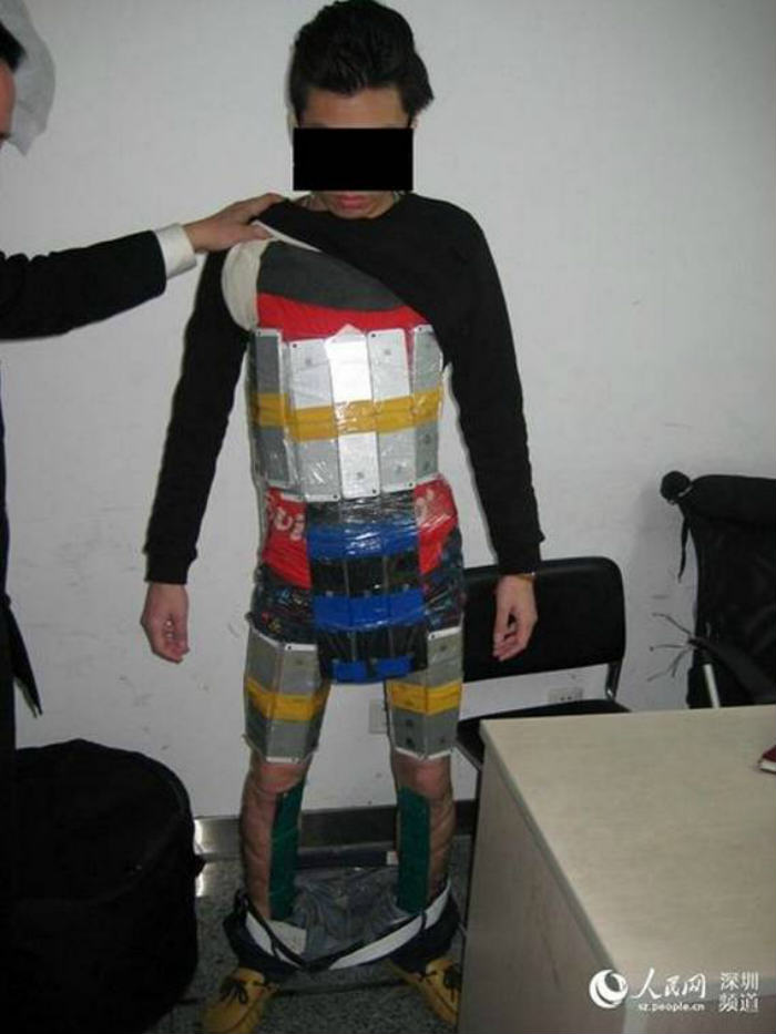 This Man Got Caught Smuggling 94 iPhones By Strapping Them To His Body ad 156543320
