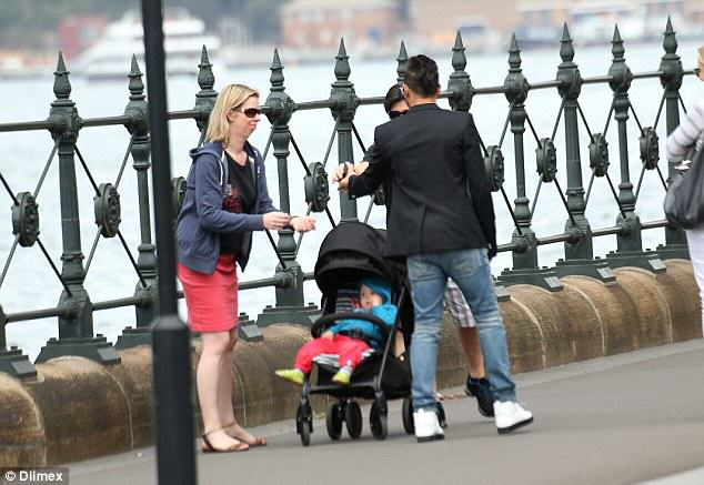 Family Ask Lewis Hamilton To Take Pic, Have No Idea Who He Is 26C8F5DF00000578 3003359 World Champion F1 Racer Lewis Hamilton was sight seeing in Sydne a 20 1426811029662