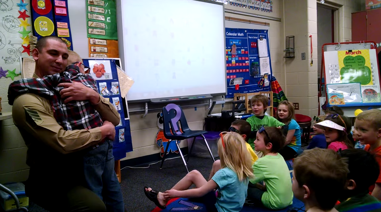 Marine Surprises His Son At School As Mystery Reader Screen Shot 2015 03 25 at 10.57.34