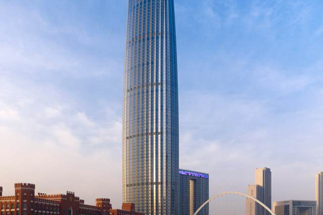 Teenager Visits China, Decides To Climb 700 Foot Skyscraper   Without Safety Gear skyscraper 640x426
