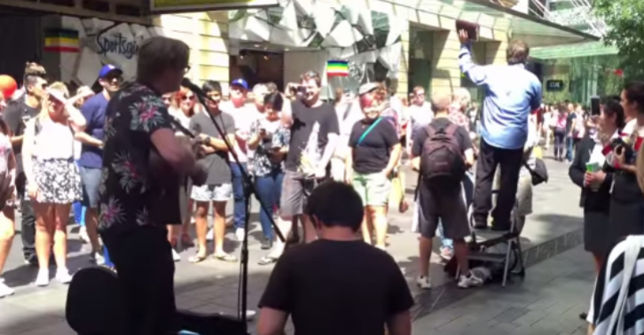 This Busker Drowns Out Homophobic Preacher By Singing Cyndi Lauper While The Crowd Join In thumb1