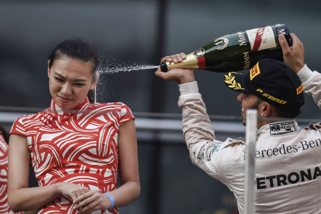 Lewis Hamilton Sprays Hostess In The Face After Winning Chinese Grand Prix Screen Shot 2015 04 14 at 12.20.13 640x426