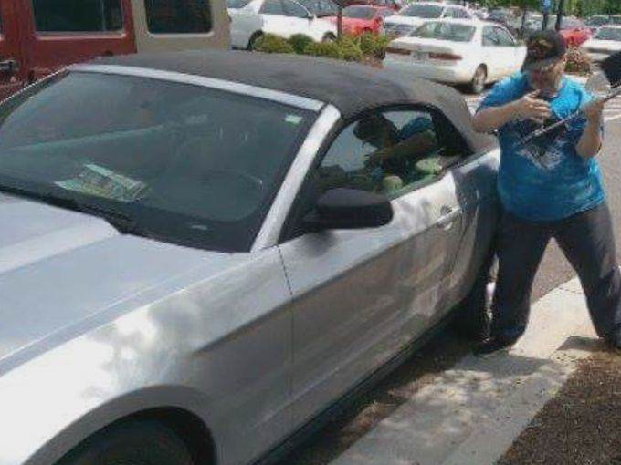 Man Arrested After Breaking Into Hot Car To Save A Dog 38