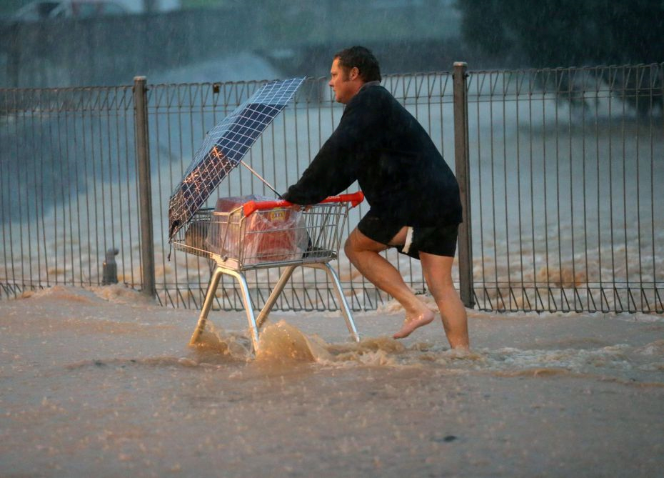 Aussie Dude Rushes Out Barefoot In Flood, All To Buy Beer beer