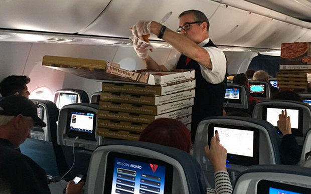 Pilot Orders Pizza For Whole Plane After Bad Delay pilot pizza