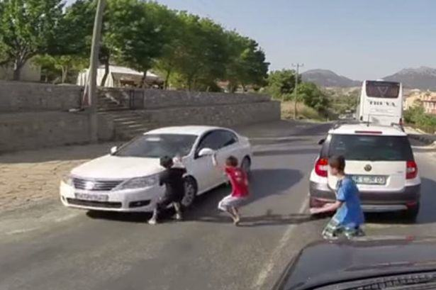 Kid Playing Chicken In Middle Of Road Hit And Dragged By Car road