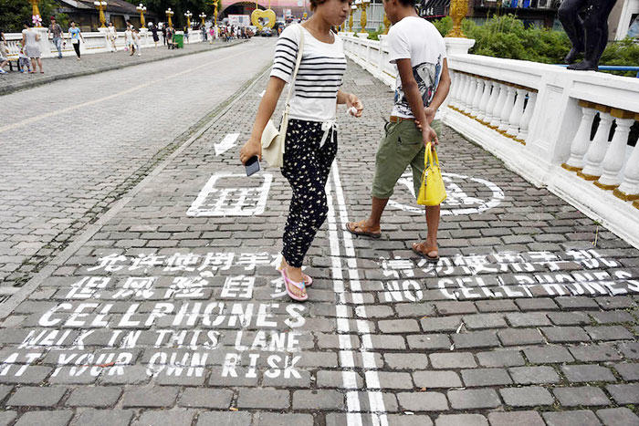 Are You Glued To Your Phone Enough To Walk In The Text Lane? 55