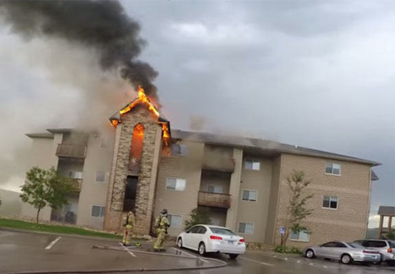 Men Film Themselves Saving Lives During Apartment Building Blaze burning apartment WEB