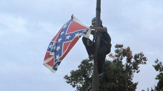 Woman In South Carolina Arrested For Taking Down Confederate Flag woman confederate flag 1