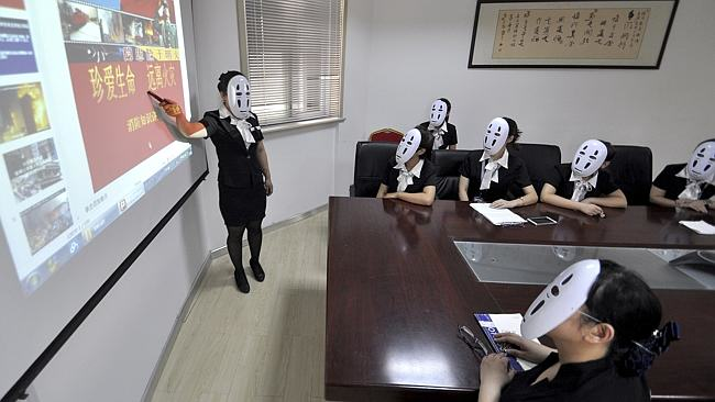 Chinese Workers Go Faceless For A Day To Avoid Faking Expressions 316