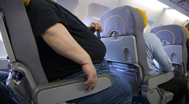 Airplane Passenger Sues For Back Injury   Caused By Sitting Next To Obese Man Iz6ORTYW52.jpg