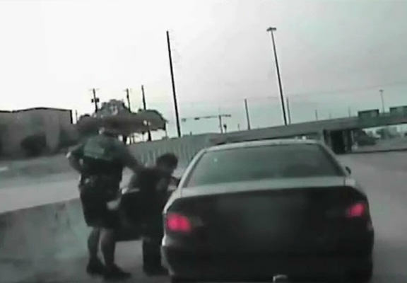 Policeman Pulls Over Driver For Talking On Phone, Saves Her Life cop saves life WEB