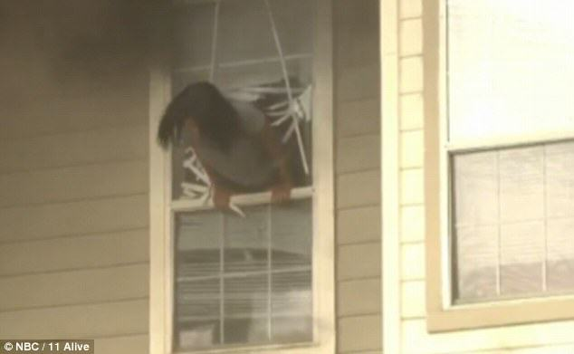 Two Girls Caught On Camera Being Forced To Jump Through A Window To Escape House Fire firewin2