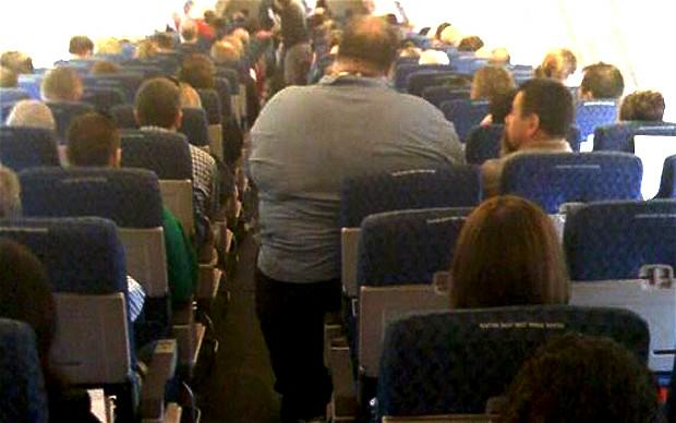 Airplane Passenger Sues For Back Injury   Caused By Sitting Next To Obese Man k8Jabmlyk1.jpg