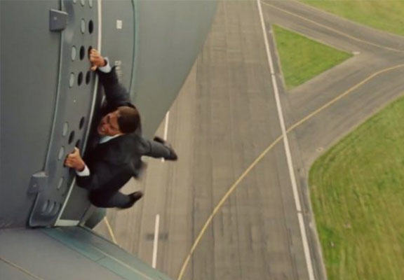Tom Cruise Hangs Off Plane In Another One Of His Own Stunts tom cruise WEB