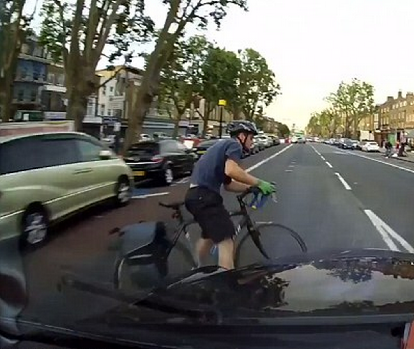 Shocking Moment Cyclist Swerves Car Door And Gets Hit By Taxi