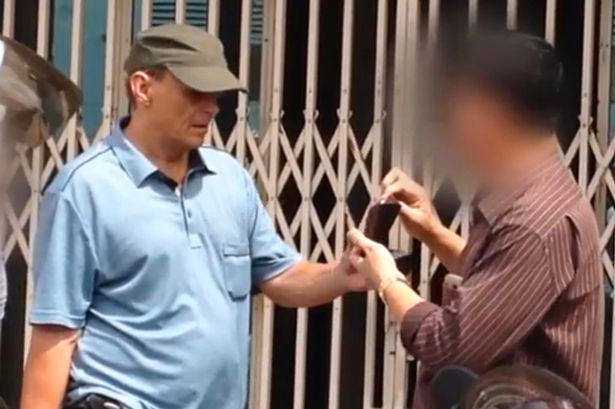 British Paedophile Locked Up After Being Pictured Holding 11 Year Olds Hand UNILAD Michael Jones photograhed in Cambodia 13