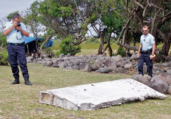 Wing Washed Up On Reunion Island Is Confirmed Flight MH370 Debris YOcpvFJ4C