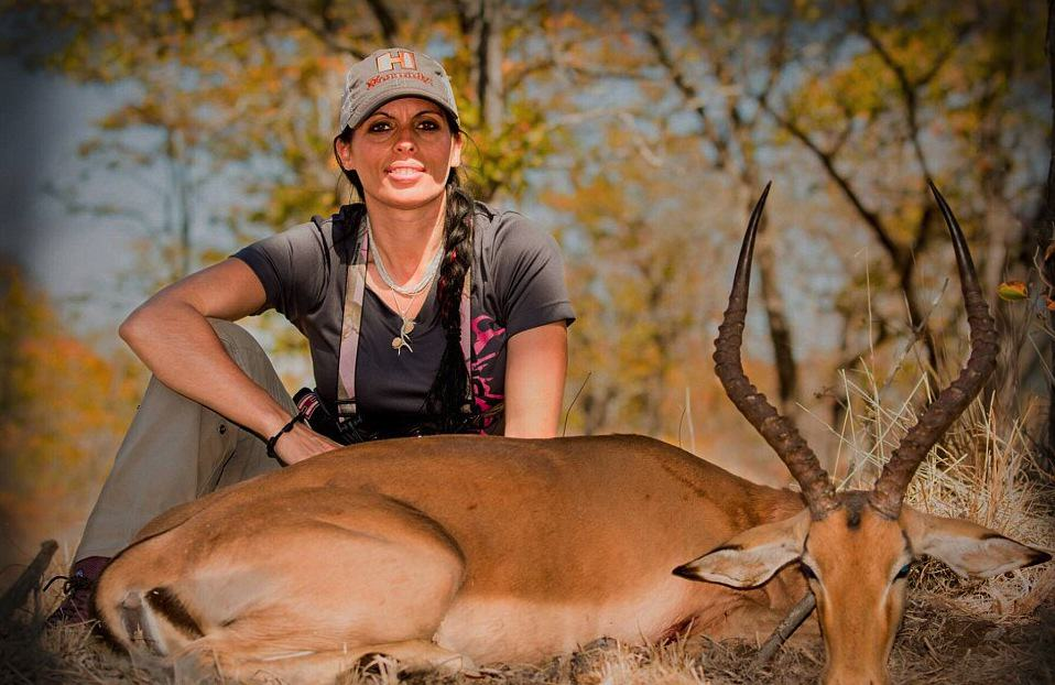 Huntress Is Posting Pictures Of Her Kills Online, Doesn't Care What 'Haters' Think pdK2pyNaT2B07142800000578 3182671 Another one Above Corgatelli poses over an impala a breed of ant a 6 1438485747877.jpg