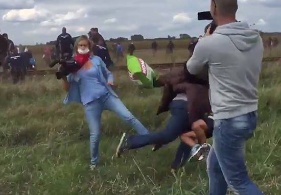 Shocking Video Shows Hungarian Camerawoman Kicking And Tripping Fleeing Refugees UNILAD 11948020 10153548319420549 988994144 n6
