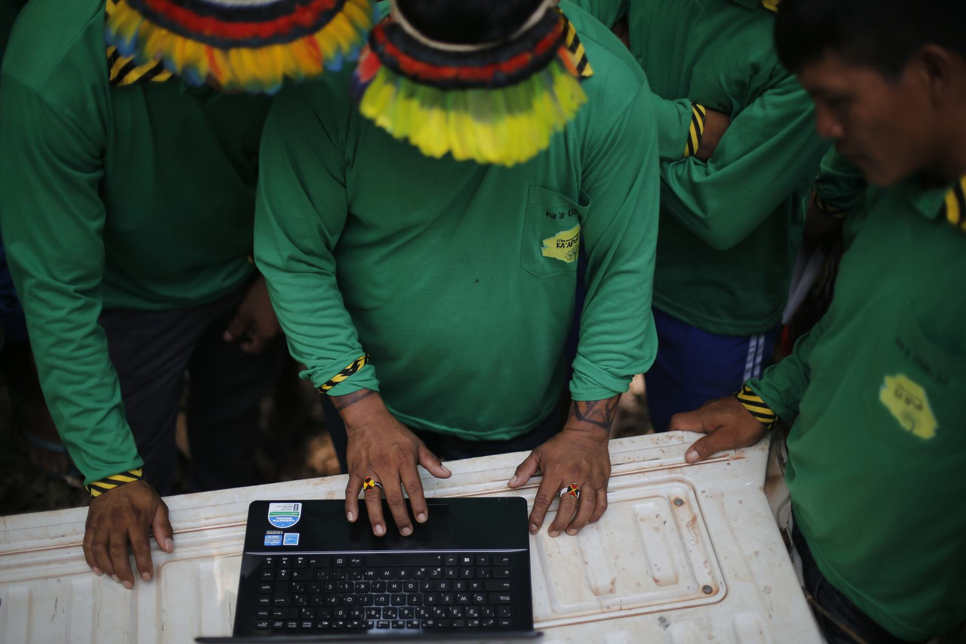 This Amazon Tribe Use Unusual Methods To Protect Their Land From Illegal Loggers UNILAD Ka'apor Indians setting up trap cameras in areas used by illegal loggers to invade the indigenous territory. Photograph Lunae ParrachoGreenpeace8
