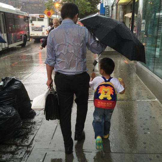 The Story Behind That Photo Of The Dad Sheltering His Son From The Rain UNILAD dad umbrella 17