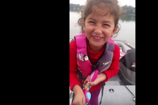 WATCH: Dad Cheers On Daughter Reeling In A Huge Fish With Her Barbie Rod fishing1 640x426