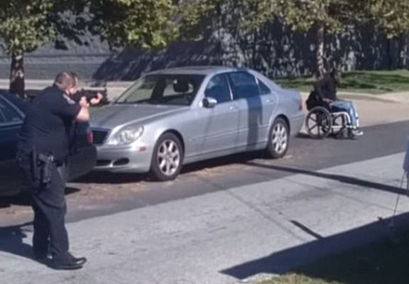 Police Caught On Camera Shooting And Killing Armed Man In A Wheelchair policeshot2