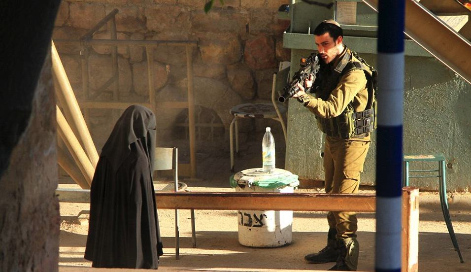 Photos Show Israeli Soldier Pointing Rifle At Student, Seconds Before She Was Killed reuters