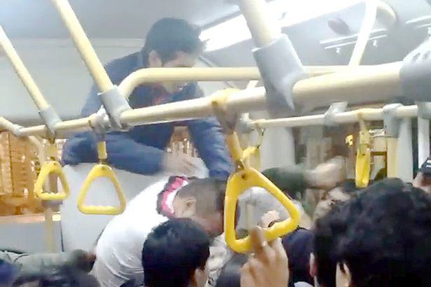Seriously Brutal Fist Fight Breaks Out On Crowded Bus UNILAD busf13