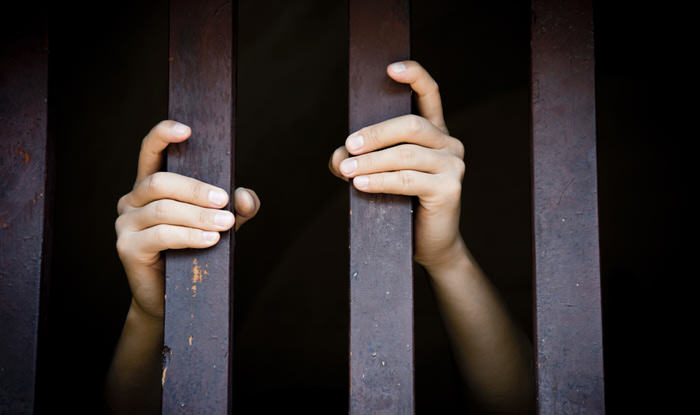 Judge Tells Young Offender You Would Probably Be Raped Every Day In Jail UNILAD hands bars prison jail58319