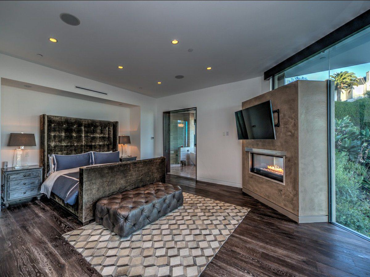 Minecraft YouTuber CaptainSparklez Buys Multi Million Pound Mansion In Hollywood UNILAD on the second floor the master bedroom has a luxurious fireplace and space for a gigantic bed9