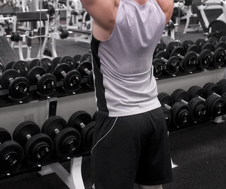 How To Tell If Someone's On Steroids 15395 a healthy young man lifting weights in a gym pv 958x800
