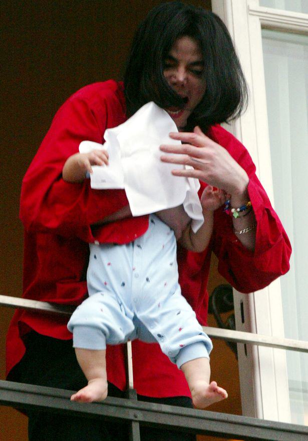 Woman Jailed For Holding Baby Out Of Window Screaming Wacko Jacko! Michael Jackson dangles his son Prince Michael II over a balcony