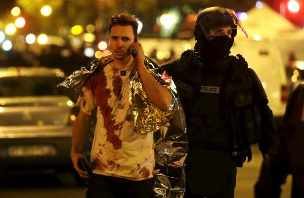 Guy Saves Girlfriend In Most Heroic Way Possible During Paris Attacks UNILAD A French policeman assists a blood covered victim near the Bataclan concert hall following attacks in Paris France72886